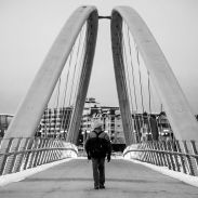 walking across the St. George's Bridge in Calgary Alberta; black and white photo